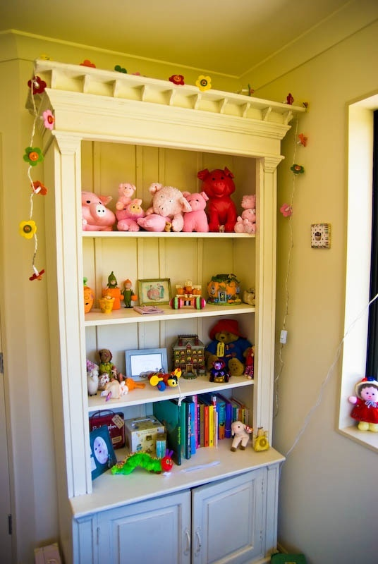 nursery shelving with lovely cabinet
