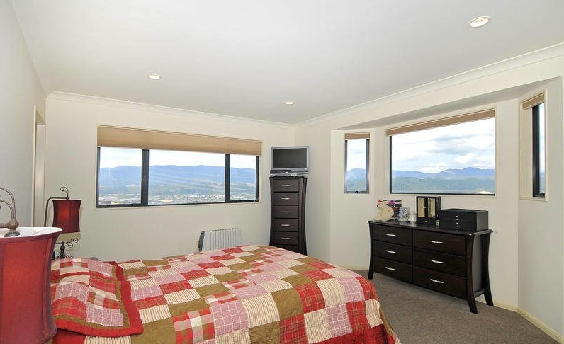 clean master bedroom with view and plenty of light