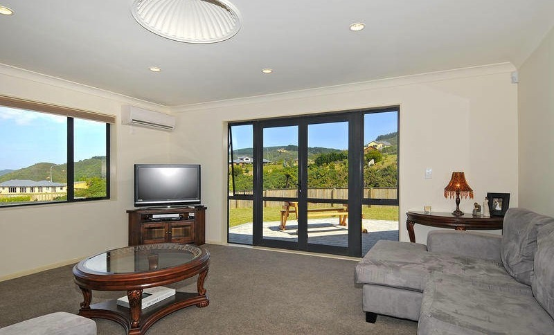 living room with lots of light and door leading to patio
