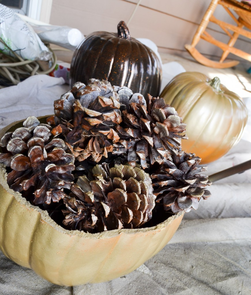 gold pumpkin and pinecones