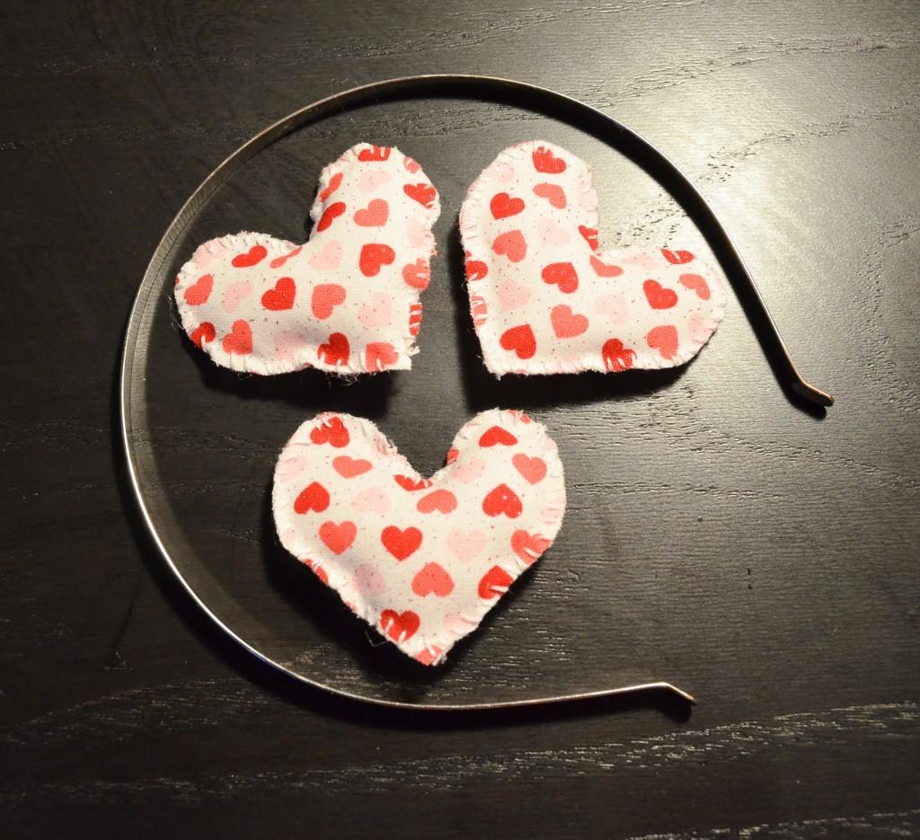 three puffy hearts