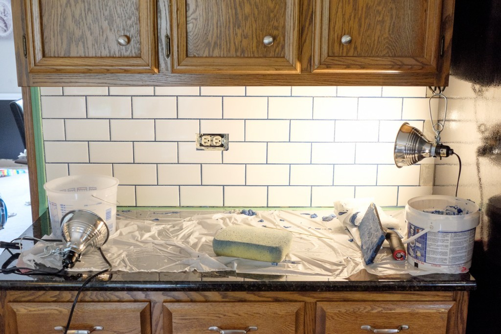 wipe off the excess grout