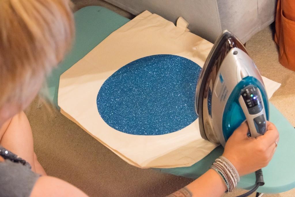 iron on the blue glitter vinyl