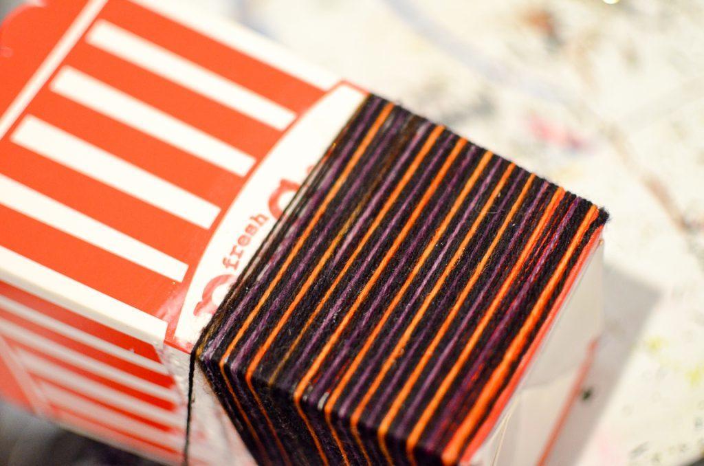 wrap the yarn around the box