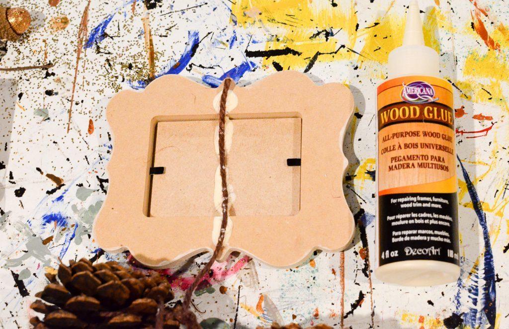 glue twine to back of frame