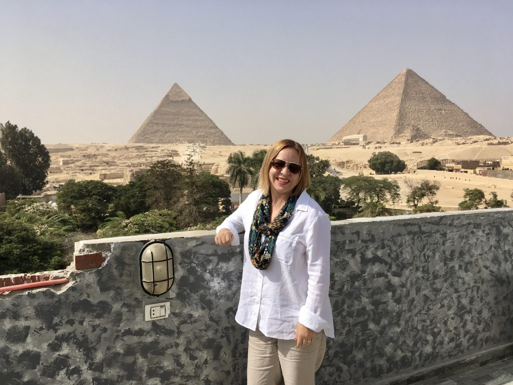 posing on the hotel roof in front of the pyramids